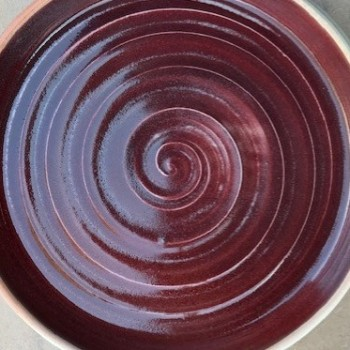 Copper red stoneware plate